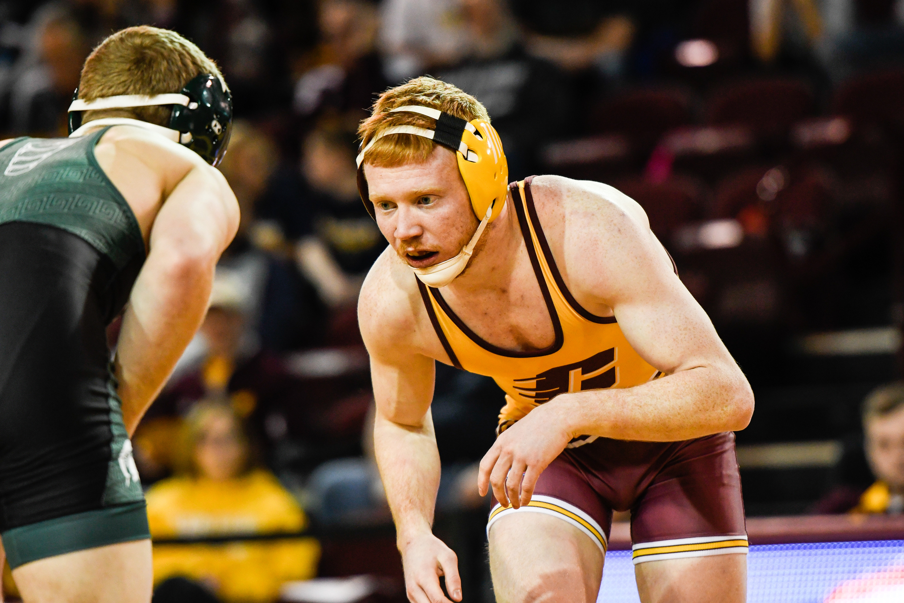 CMU junior Justin Oliver (right) will wrestle on Saturday morning for a spot in